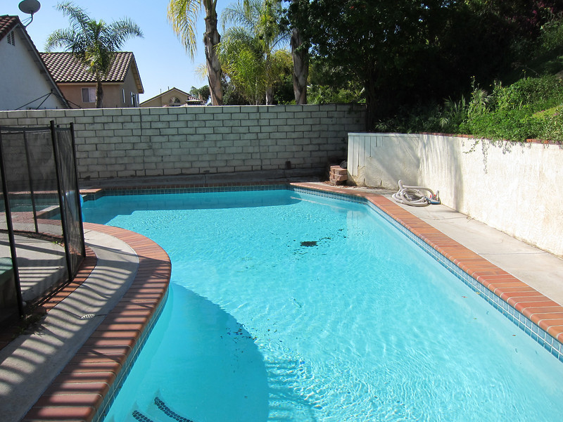 In-ground pool with removable fence...