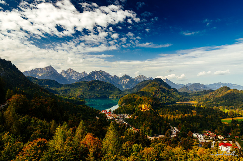 Beautiful panorama of the Hohenschwangau Castle, Lake Alpsee and the Allau Alps