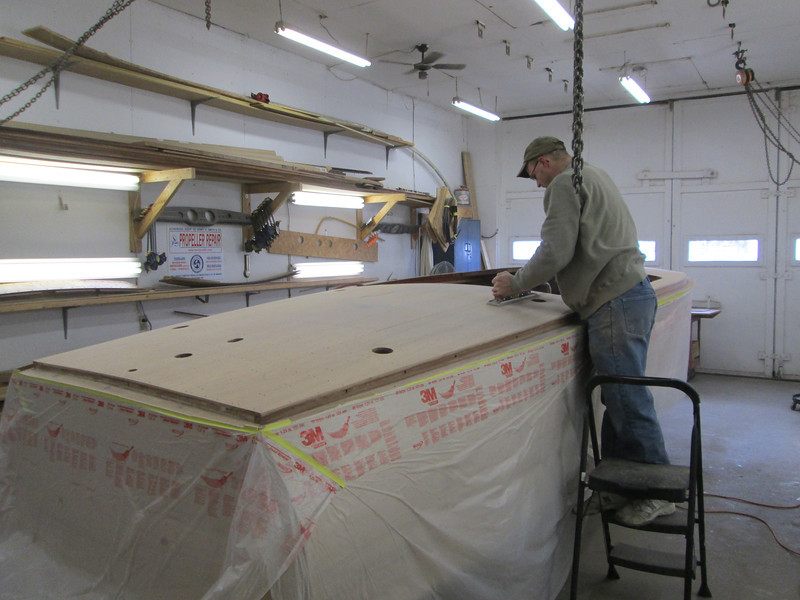 Sanding the rear deck.
