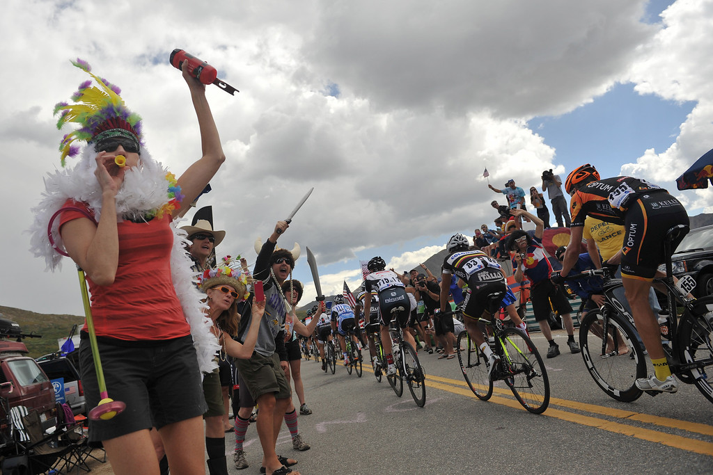. Fans cheer the cyclists at the top of Independence Pass during 126.4 mi second stage of the 2013 USA Pro Challenge race from Aspen to Breckenridge.   (Photo By Hyoung Chang/The Denver Post)