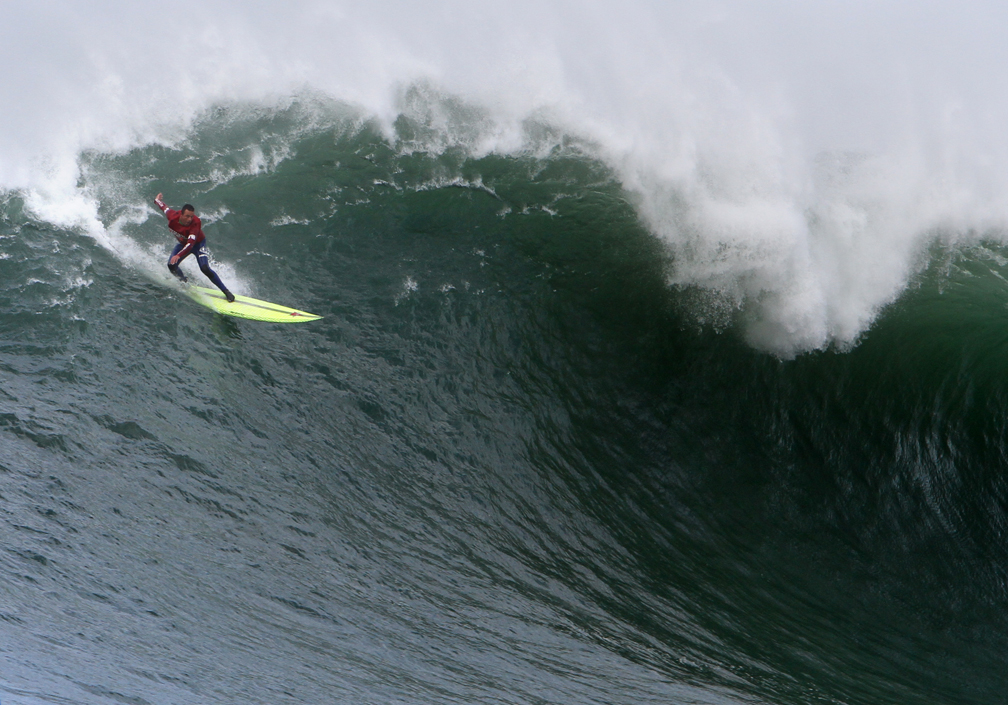 . Big Wave surfer Anthony Tashnick readies to plummet down a wave during the semifinal heat at the Mavericks Invitational surf competition in Half Moon Bay on Friday. (Kevin Johnson/Sentinel)