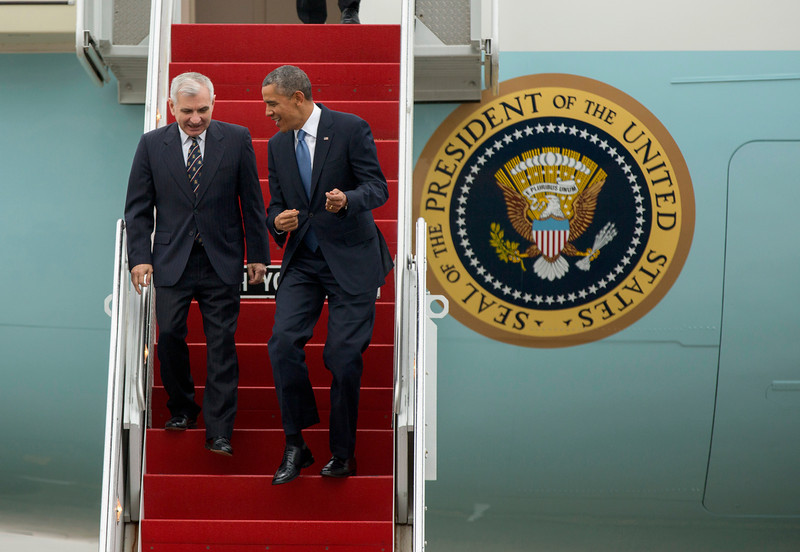 . President Barack Obama and Senate Armed Service Committee member Sen. Jack Reed, D-R.I., laugh as they walk down the steps from Air Force One, upon their arrival at the Stewart Air National Guard Base in Newburgh, N.Y., Wednesday, May 28, 2014, before heading to the United States Military Academy at West Point where the president was to deliver the commencement address. (AP Photo/Philip Kamrass)