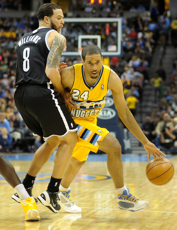 . DENVER, CO. - MARCH 29: Andre Miller (24) of the Denver Nuggets tried to swing around Deron Williams (8) of the Brooklyn Nets in the first half. The Denver Nuggets hosted the Brooklyn Nets Friday night, March 29, 2013 at the Pepsi Center in Denver.  (Photo By Karl Gehring/The Denver Post)