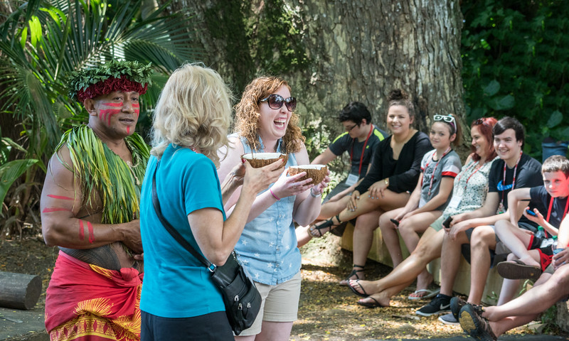 Volunteers sampling coconut