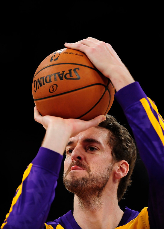 . Los Angeles Lakers center Pau Gasol (16), of Spain, warms up before the start of an NBA basketball game against the New Orleans Pelicans, Tuesday, March 4, 2014, in Los Angeles.(AP Photo/Gus Ruelas)