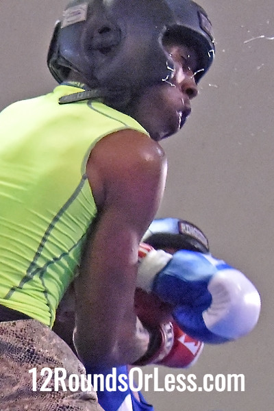Bout 10=Main Event Daywaun Roseberry, Blue Gloves, Unattached, Cleveland -vs-Tracey McGruder, Red Gloves, St. Martin BC, Rochester, NY, 152 lbs