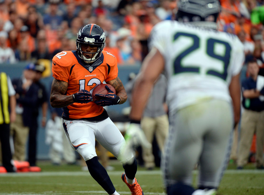 . Wide receiver Andre Caldwell (12) of the Denver Broncos makes a catch at the two yard line during the first quarter.  The Denver Broncos vs the Seattle Seahawks At Sports Authority Field at Mile High. (Photo by John Leyba/The Denver Post)