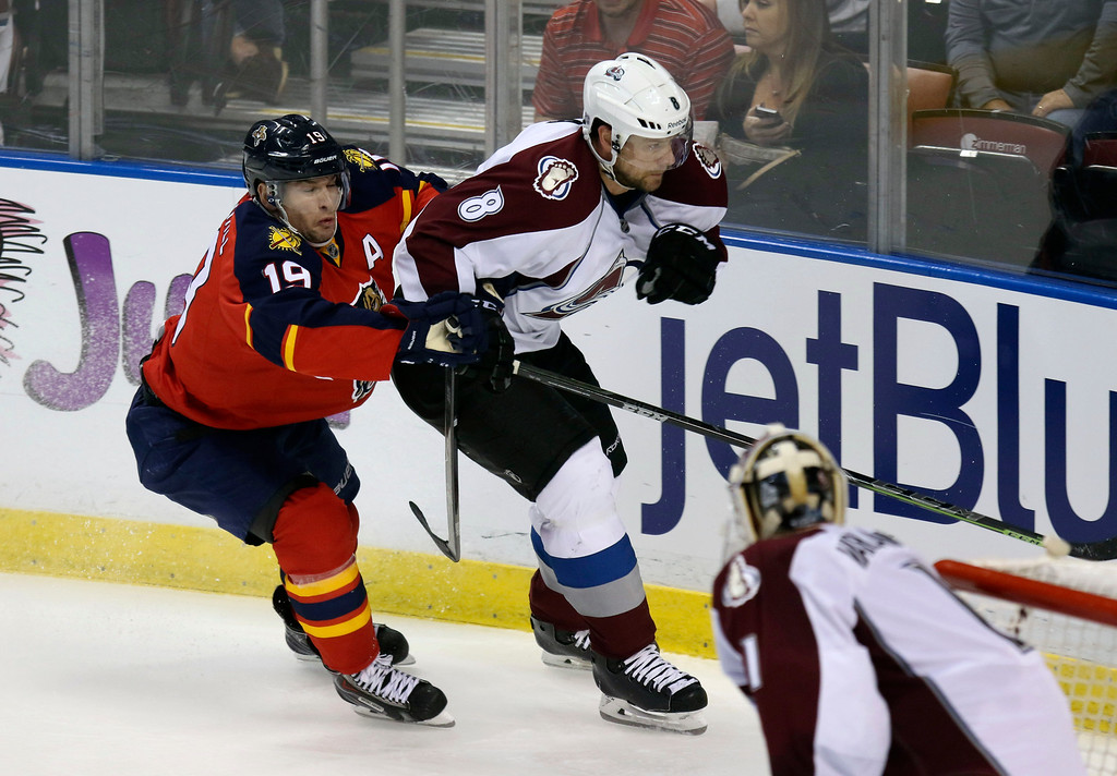. Florida Panthers\' Scottie Upshall (19) tries to block Colorado Avalanche\' Jan Hejda (8) during the second period of an NHL hockey game, Thursday, Jan.15, 2015 in Sunrise, Fla. (AP Photo/J Pat Carter)