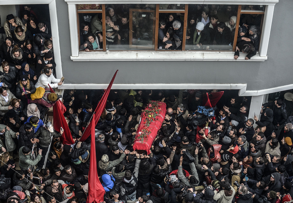 . The coffin of Berkin Elvan is carried   on March 11, 2014, in Istanbul. Berkin Elvan, who has been in a coma since June 2013 after being struck in the head by a gas canister during a police crackdown on protesters, died March 11, his family announced via Twitter. The young teenager, the eighth person to be killed in the Gezi Park protests, went into a coma after sustaining a head injury from a gas canister as he went to buy bread during a police crackdown in Istanbul\'s Okmeydanõ neighborhood last June. Elvan has since become one of the prime symbols violence faced by protesters throughout the nationwide Gezi demonstrations. (BULENT KILIC/AFP/Getty Images)