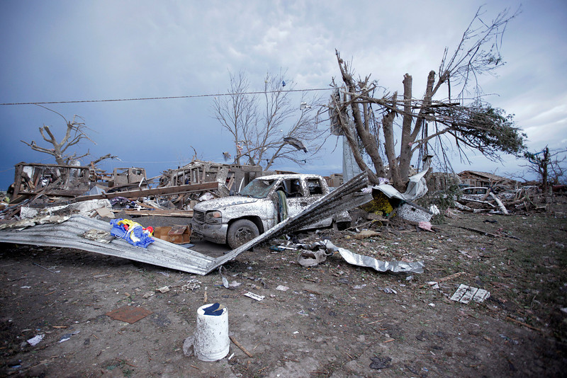 . Piles of debris and cars lie around a home destroyed by a tornado May 21, 2013 in Moore, Oklahoma. The town reported a tornado of at least EF4 strength and two miles wide that touched down yesterday killing at least 24 people and leveling everything in its path. U.S. President Barack Obama promised federal aid to supplement state and local recovery efforts.  (Photo by Brett Deering/Getty Images)