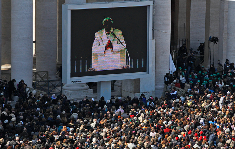 ". Pope Benedict XVI is seen on a giant screen during his last general audience in St. Peter\'s Square, at the Vatican, Wednesday, Feb. 27, 2013. Benedict XVI basked in an emotional sendoff Wednesday at his final general audience in St. Peter\'s Square, recalling moments of ""joy and light\"" during his papacy but also times of great difficulty. He also thanked his flock for respecting his decision to retire. (AP Photo/Andrew Medichini)"