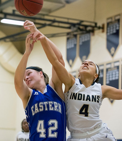 01/03/19 Wesley Bunnell | Staff Newington girls basketball vs Bristol Eastern at home Friday December 3, 2019. Bristol Eastern's Avery Arbuckle (42) matched against Newington's Alexie Armour (4).
