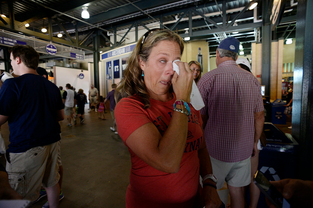 . Gina Gonzales wipes her tears as she talks about her son St. Louis Cardinals starting pitcher Marco Gonzales (56) after his performance in his major league debut agains the Colorado Rockies June 25, 2014 at Coors Field. (Photo by John Leyba/The Denver Post)