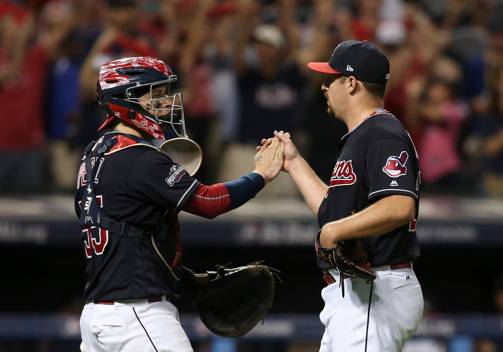. Cleveland Indians relief pitcher Bryan Shaw, right, celebrates with catcher Roberto Perez after Game 2 of baseball\'s American League Division Series against the Boston Red Sox, Friday, Oct. 7, 2016, in Cleveland. (AP Photo/Aaron Josefczyk)