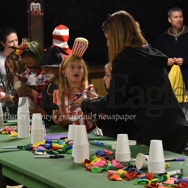 Eight-year-old Ellie Edmisten, of Zelienople, and her mom, Jessica, put the finishing touches on one of several art projects offered during Saturday's Camp Creepy event hosted by Girl Scouts of Western Pennsylvania at Camp Redwing in Renfrew. The mother and daughter were among the nearly 1,000 participants from throughout the region who came out for annual Halloween-themed event that featured activities, campfires, trick-or-treating and all kinds of other spooktacular fun ran by Girl Scout Cadets and their troop leaders. The event was the first of three such events this month. The other two will be held at Girl Scout camps in Erie and Johnstown. ANDIE HANNON/BUTLER EAGLE