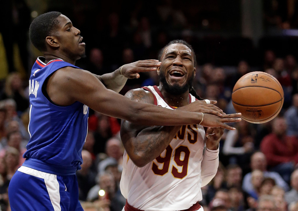 . Los Angeles Clippers\' Jawun Evans, left, knocks the ball loose from Cleveland Cavaliers\' Jae Crowder during the first half of an NBA basketball game, Friday, Nov. 17, 2017, in Cleveland. (AP Photo/Tony Dejak)