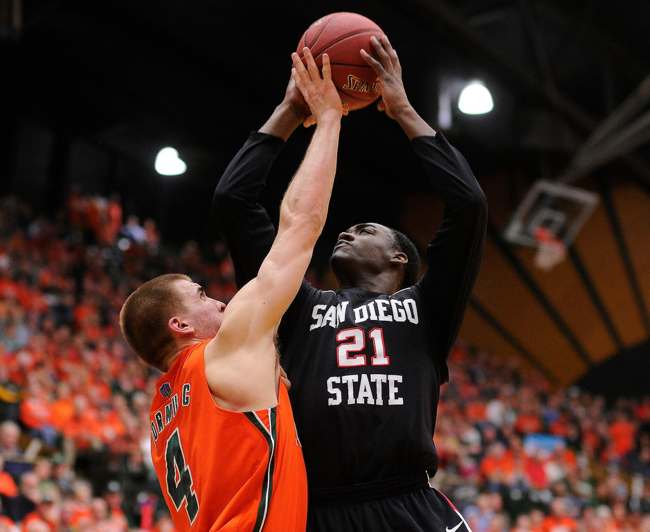 . FT. COLLINS, CO. - FEBRUARY 13: Pierce Hornung (4) of the Colorado State Rams went for a block on Jamaal Franklin (21) of the San Diego State Aztecs in the first half. Colorado State hosted San Diego State February 13, 2013 at Moby Arena in Fort Collins. (Photo By Karl Gehring/The Denver Post)