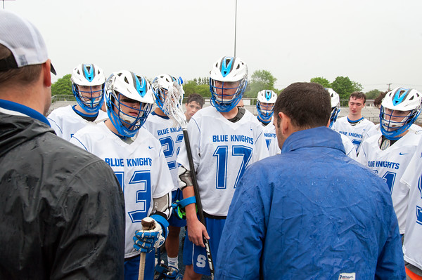05/22/18 Wesley Bunnell | Staff Southington lacrosse had their season ended with a loss to Glastonbury on Tuesday afternoon at Southington High School. Coaches speaks to players at the end of the game including Camden Brown (13) and Eli Steindl (17).