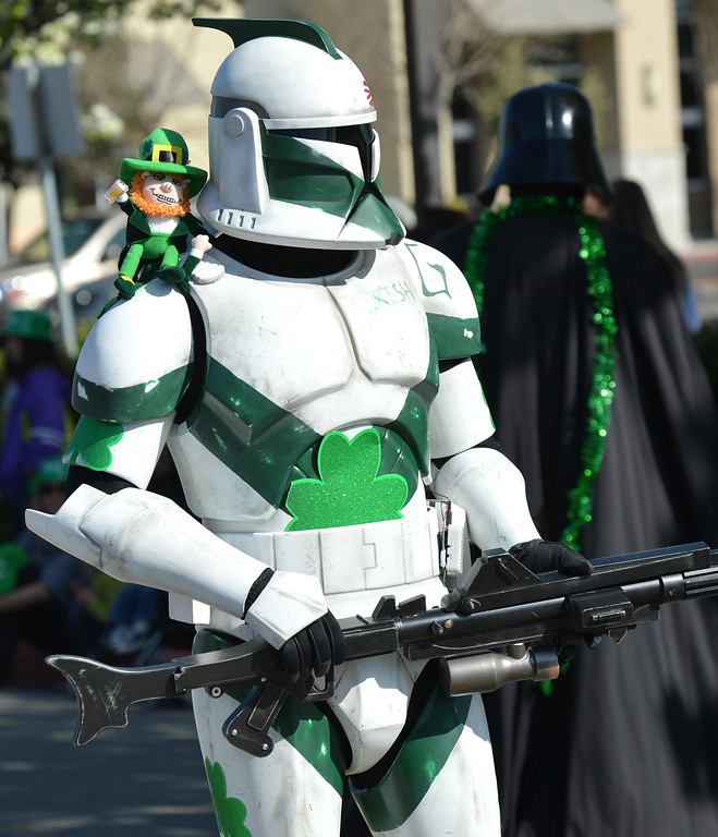 . A Star Wars character from The Worlds Definitive Imperial Costuming Organization stands with a leprechaun on his shoulder during the Saint Patrick\'s Day Parade in Dublin, Calif., on Saturday, March 16, 2013. (Dan Rosenstrauch/Staff)