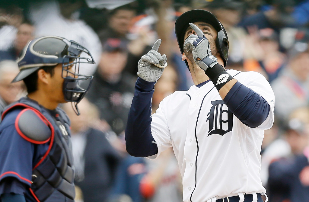 . Detroit Tigers\' J.D. Martinez looks skyward after his solo home run during the second inning of an opening day baseball game against the Minnesota Twins in Detroit, Monday, April 6, 2015. (AP Photo/Carlos Osorio)