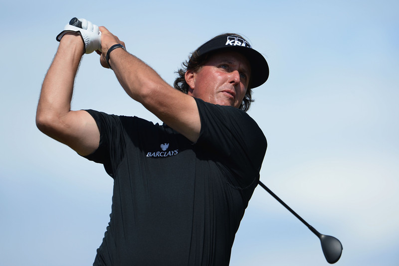 . Phil Mickelson of the United States tees off during the first round of the 142nd Open Championship at Muirfield on July 18, 2013 in Gullane, Scotland.  (Photo by Stuart Franklin/Getty Images)