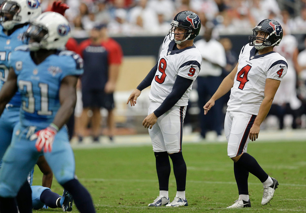 . Houston Texans kicker Randy Bullock (4) and holder Shane Lechler (9) lean as they watch a field goal-attempt fail during the second quarter of an NFL football game against the Tennessee Titans, Sunday, Sept. 15, 2013, in Houston. (AP Photo/David J. Phillip)