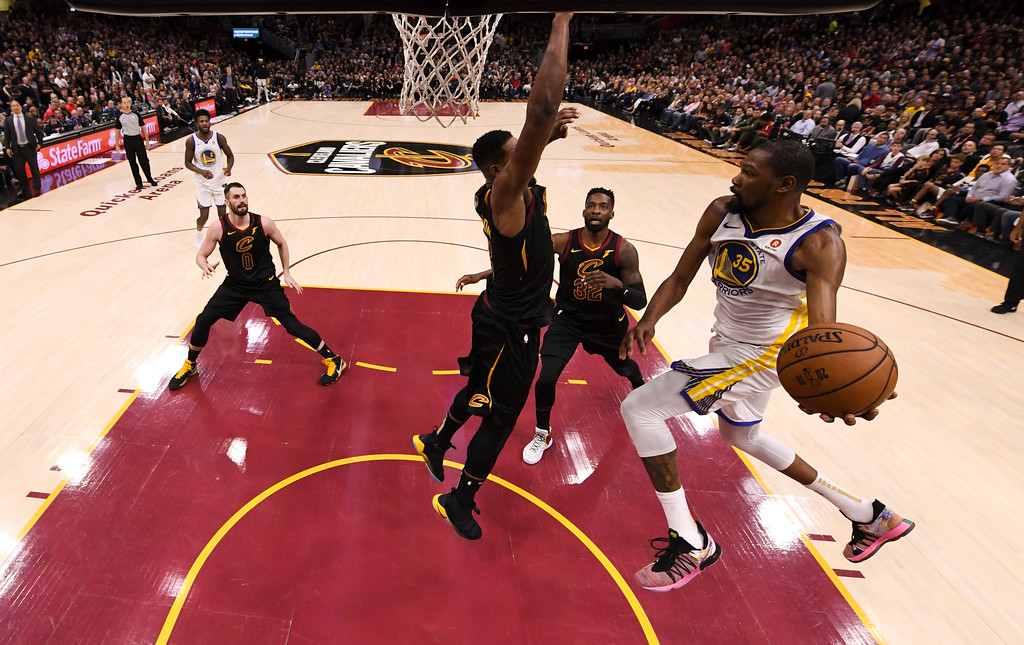 . Golden State Warriors forward Kevin Durant (35) passes the ball in front of Cleveland Cavaliers forward Jeff Green (32) and another defender during the second half of Game 3 of basketball\'s NBA Finals, Wednesday, June 6, 2018, in Cleveland. The Warriors defeated the Cavaliers 110-102 to take a 3-0 lead in the series. (Kyle Terada/Pool Photo via AP)