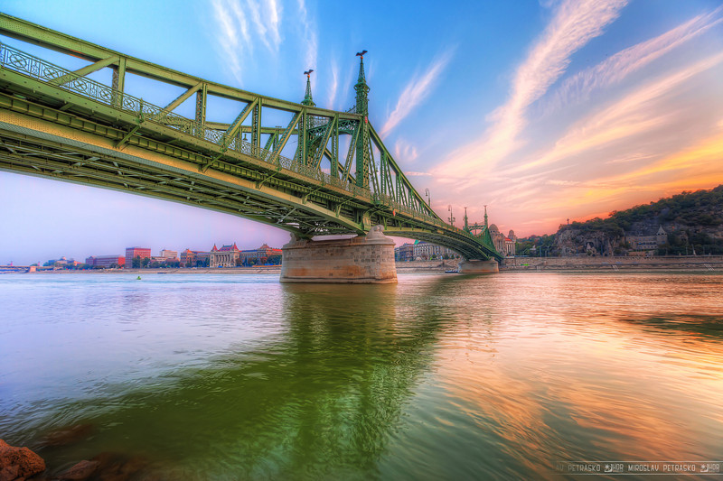 Not a very colorful sunset Comparing to my recent photos, this one is not so colorful. But as the sunset when I took it wasn't colorful at all, I had to add a lot of saturation. For those interested, this is the Liberty bridge in Budapest.