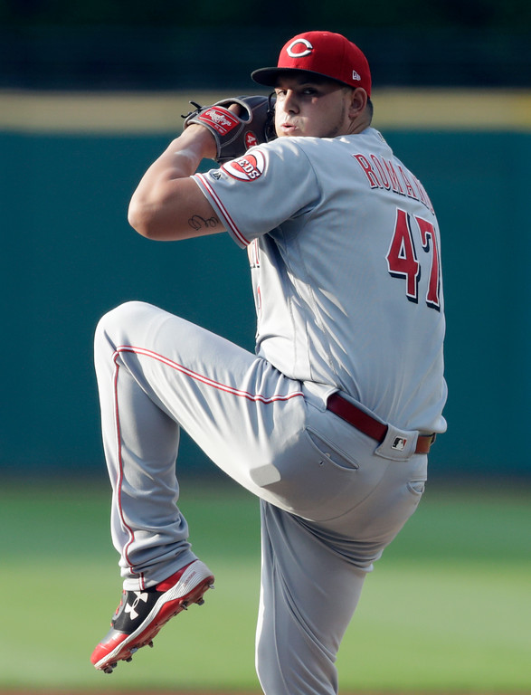 . Cincinnati Reds starting pitcher Sal Romano delivers in the first inning of a baseball game against the Cleveland Indians, Tuesday, July 10, 2018, in Cleveland. (AP Photo/Tony Dejak)