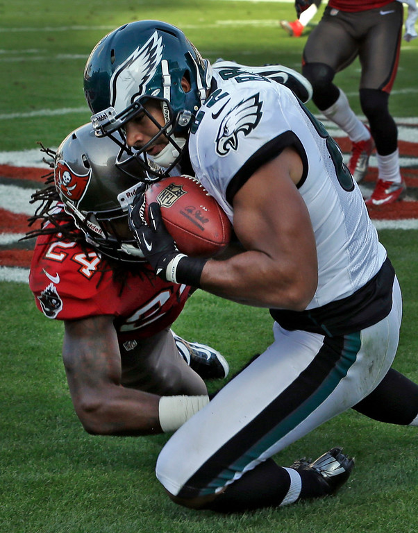 . Philadelphia Eagles tight end Clay Harbor (82) pulls in a touchdown in front of Tampa Bay Buccaneers strong safety Mark Barron (24) during the fourth quarter of an NFL football game Sunday, Dec. 9, 2012, in Tampa, Fla. The Eagles won the game 23-21.(AP Photo/Chris O\'Meara)