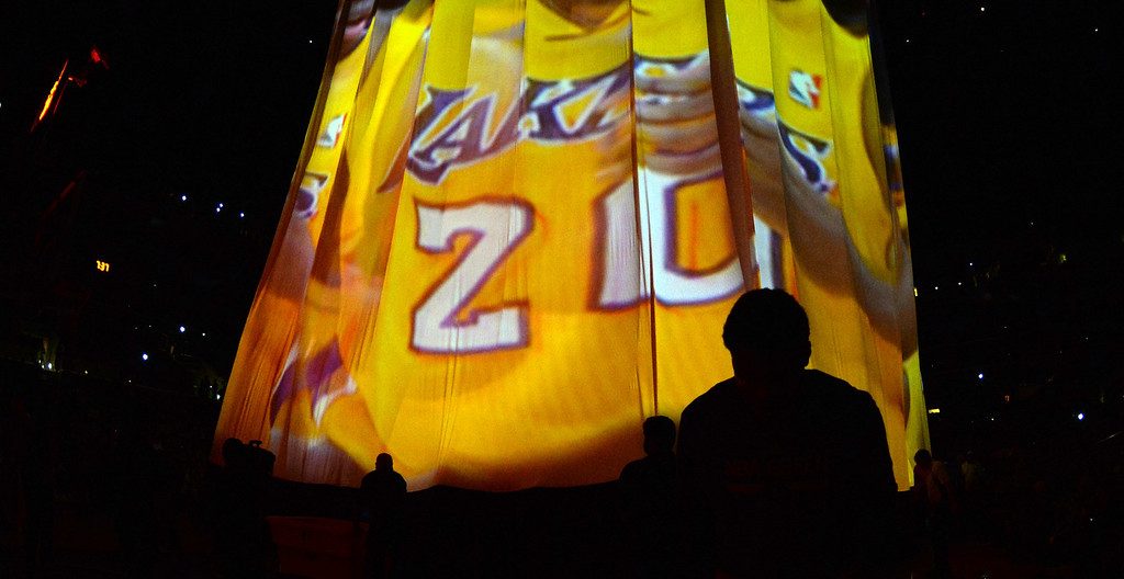 . The Los Angeles Lakers are announced prior to a NBA basketball game against the Dallas Mavericks in Los Angeles, Calif., on Friday, April 4, 2014.  (Keith Birmingham Pasadena Star-News)