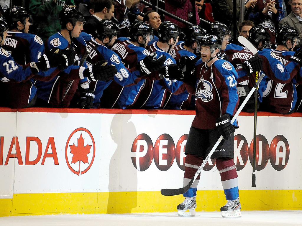 . Colorado Avalanche right wing Milan Hejduk (23), of the Czech Republic, celebrates a goal against the Chicago Blackhawks with teammates during the second period of an NHL hockey game, Monday, March 18, 2013, in Denver. (AP Photo/Jack Dempsey)