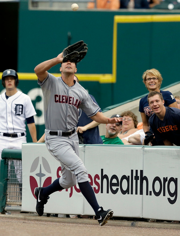 . Cleveland Indians right fielder David Murphy catches the pop-up hit by Detroit Tigers J.D. Martinez during the second inning of a baseball game in Detroit, Friday, July 18, 2014. (AP Photo/Carlos Osorio)