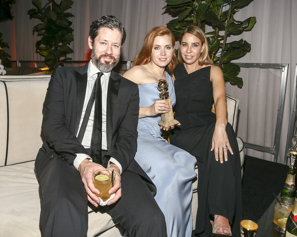 . Darren Le Gallo, actress Amy Adams and a guest attend The Beverly Hilton Hotel on January 11, 2015 in Beverly Hills, California.  (Photo by Rich Polk/Getty Images for FIJI Water)