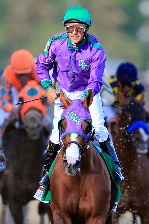 . Jockey Victor Espinoza celebrates atop of California Chrome #5 after crossing the finish line to win the 140th running of the Kentucky Derby at Churchill Downs on May 3, 2014 in Louisville, Kentucky.  (Photo by Rob Carr/Getty Images)