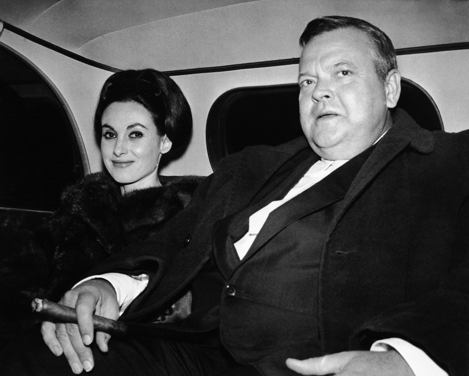 . American Actor Orson Welles and his wife Paola Mori, ride car as they leave their London Hotel, Oct. 29, 1963, twenty-five years after his famous dramatization of �The War of the Worlds� the Broadcast, adapted from H.G. Wells Novel, was aired in October 1938 and caused a mass scare in the U.S. (AP Photo)