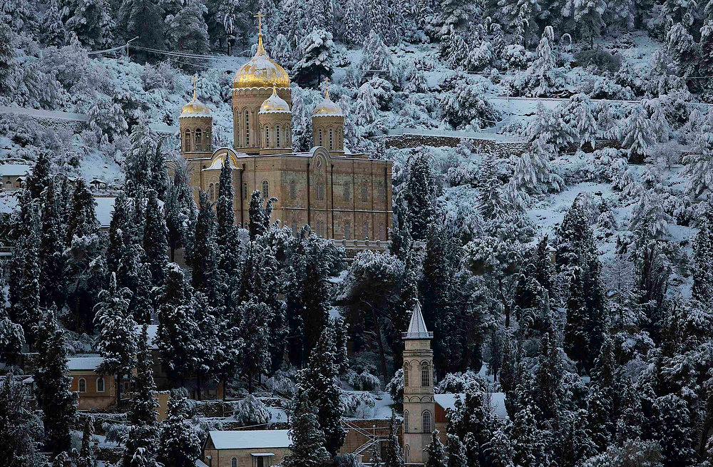 Description of . Snow covers the Russian Church over the neighbourhood of Ein Kerem and the western outskirts of Jerusalem January 10, 2013.The worst snowstorm in 20 years shut public transport, roads and schools in Jerusalem on Thursday and along the northern Israeli region bordering on Lebanon. REUTERS/Ronen Zvulun