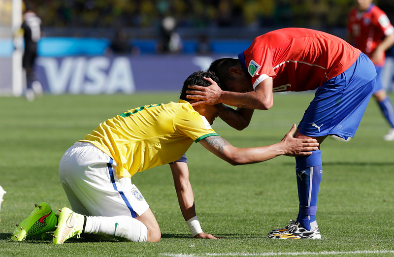 . Brazil\'s Thiago Silva, left, is greeted by Chile\'s Mauricio Pinilla after a challenge during the World Cup round of 16 soccer match between Brazil and Chile at the Mineirao Stadium in Belo Horizonte, Brazil, Saturday, June 28, 2014. (AP Photo/Andre Penner)