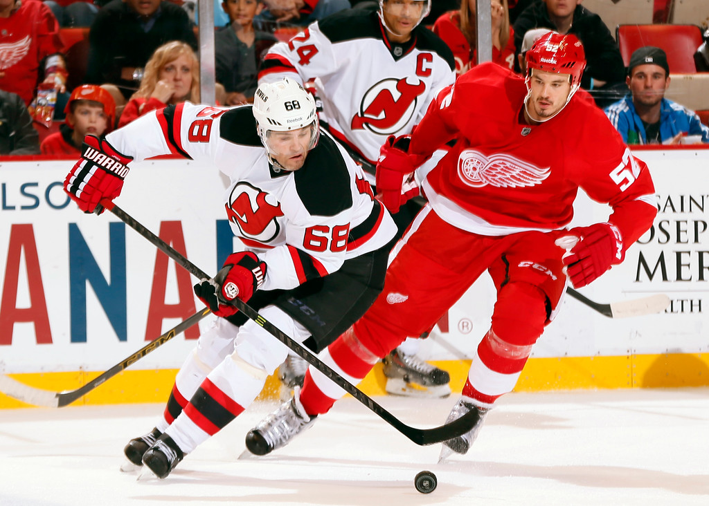 . New Jersey Devils right wing Jaromir Jagr (68) skates as Detroit Red Wings defenseman Jonathan Ericsson (52) defends in the second period of an NHL hockey game in Detroit, Friday, Nov. 7, 2014. (AP Photo/Paul Sancya)