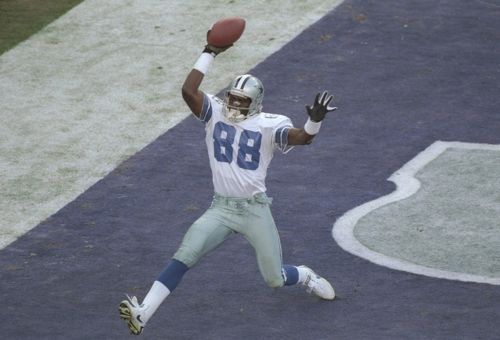 Description of . 28 Jan 1996:  Wide receiver Michael Irvin of the Dallas Cowboys scores a touchdown during Super Bowl XXX against the Pittsburgh Steelers at Sun Devil Stadium in Tempe, Arizona.  Although the touchdown was nullified by a penalty, the Cowboys won the game, 27-17. Mandatory Credit: Al Bello  /Allsport