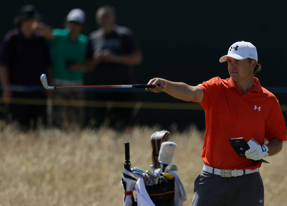 . Jordan Spieth of the United States prepares to play a shot on the 18th hole during the second round of the British Open Golf Championship at Muirfield, Scotland, Friday July 19, 2013. (AP Photo/Jon Super)
