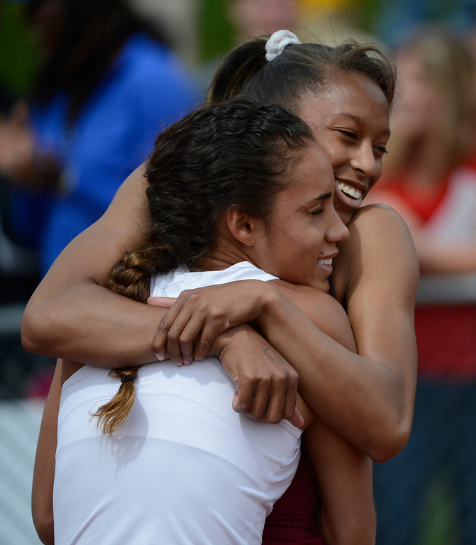 . LAKEWOOD, CO - MAY 18:  Ana Holland, Regis Jesuit, left, gets a congratulatory hug from competitor, Shayna Yon, Cherokee Trail High School after Holland won the girls 5A 100 meter race at the Colorado State Track and Field Championships at Jeffco Stadium, Saturday morning, May 18, 2013. Holland won with a time of 11.33, a new meet record. (Photo By Andy Cross/The Denver Post)