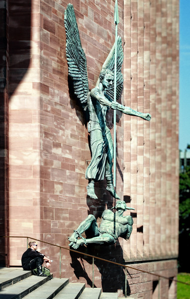 St. Michael defeating the devil - sculpture on the wall of the new Coventry Cathedral