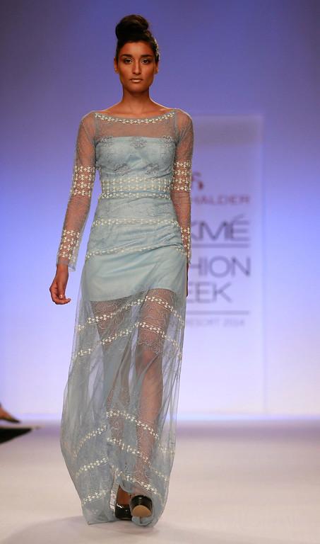 . A model displays a creation by designer Abdul Halder during the Lakme Fashion Week in Mumbai, India, Thursday, March 13, 2014. (AP Photo/Rafiq Maqbool)