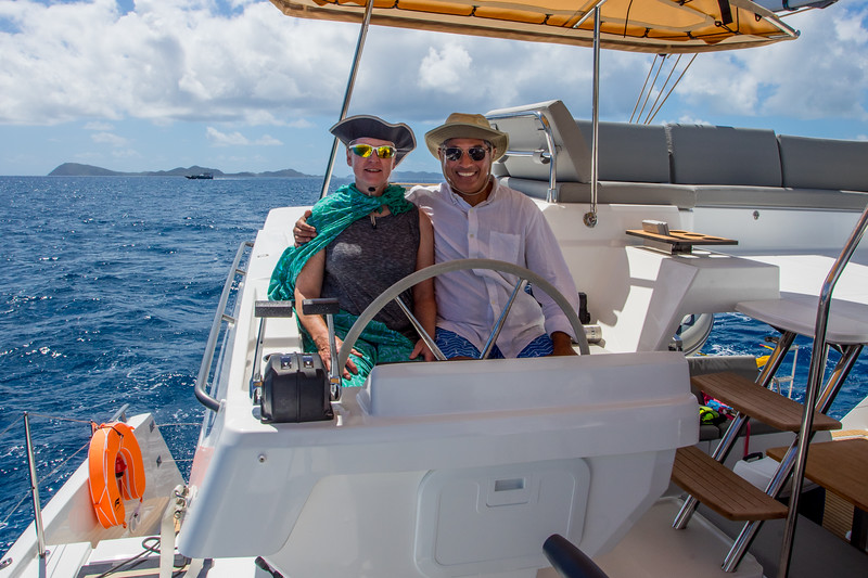 Rob took this picture of me and Linda.  no hands on the helm as we had engaged the autopilot on a constant wind angle.  A super nifty  way to be lazy!