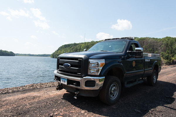 08/29/18 Wesley Bunnell | Staff A truck used to patrol Shuttle Meadow Reservoir parked on Caretaker Road on Wednesday afternoon.