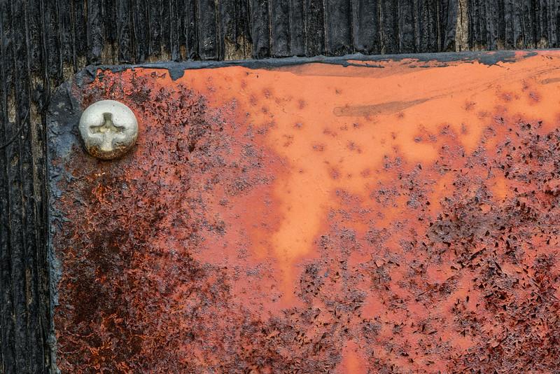 Corner Screw on Orange Sign