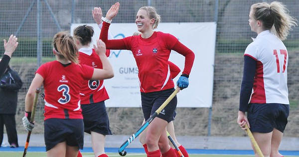 Merchant gets a hat-trick as the Uni girls step three points closer to the title.