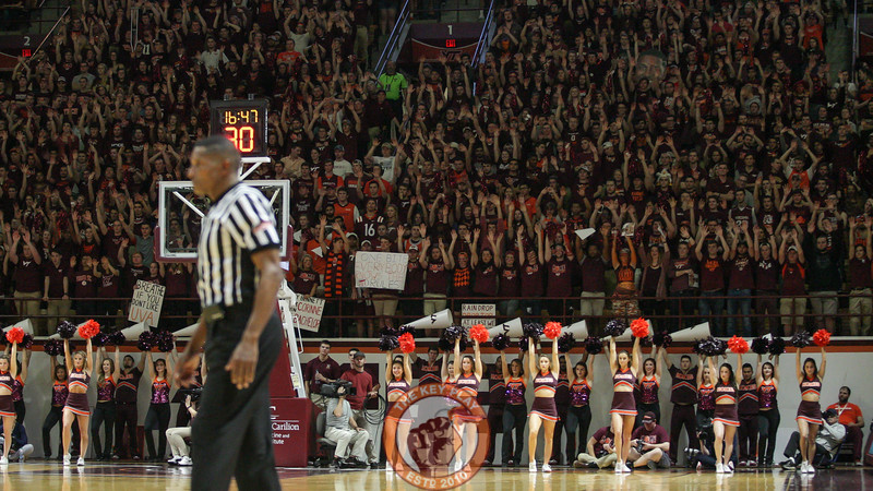 The student section and cheerleaders hold up their arms during a Virginia Tech free throw attempt. (Mark Umansky/TheKeyPlay.com)