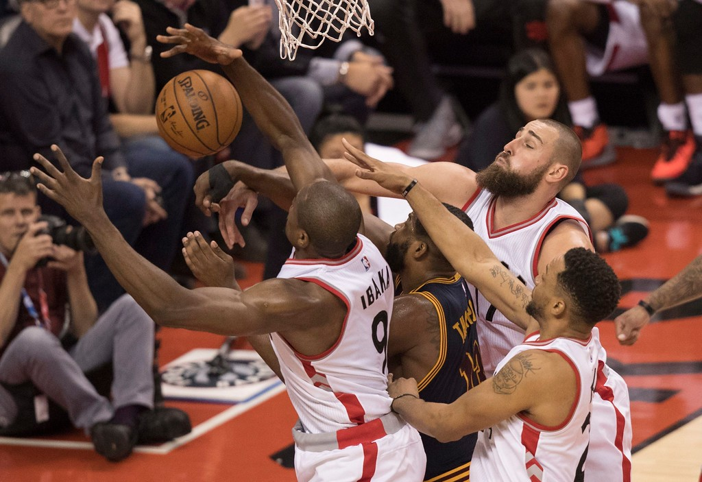 . Cleveland Cavaliers center Tristan Thompson (13) battles for the ball with Toronto Raptors forward Serge Ibaka (9), Raptors center Jonas Valanciunas (17) and Raptors guard Norman Powell (24) during the second half of Game 3 of an NBA basketball second-round playoff series in Toronto on Friday, May 5, 2017. (Fred Thornhill/The Canadian Press via AP)